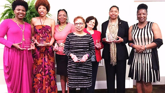 Local and national recipients of the Emmett Till 2015 Woman of Courage Awards pose with one of the 2014 awardees, Ann Richards, far right.