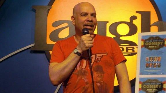 Jason Stuart performs standup at the Laugh Factory.