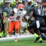 "Bowling Green Falcons running back Travis Greene looks for room to run. ""We want balance. We want to run the football,"" Falcons coach Dino Babers says. ""We don't want to throw it every snap. But we're going to take what the defense gives us. We're not going to be hard-headed about it."""