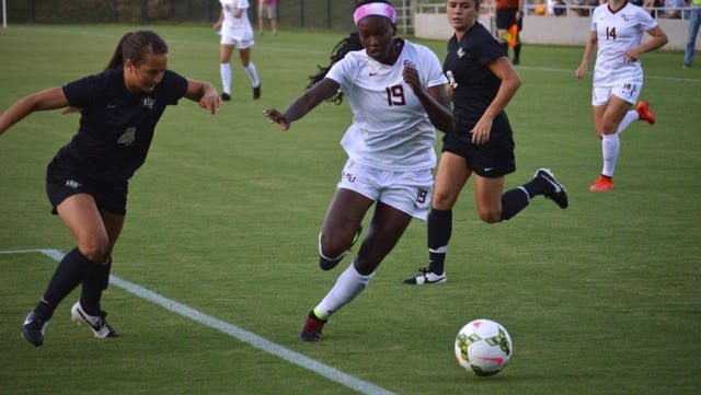 Cheyna Williams takes on a UCF defender as the Noles defeated the Knights 4-0.