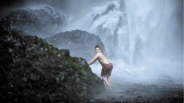 John Bobzien of Portland cools off in the splash pool of Latourell Falls along the Columbia River Gorge.