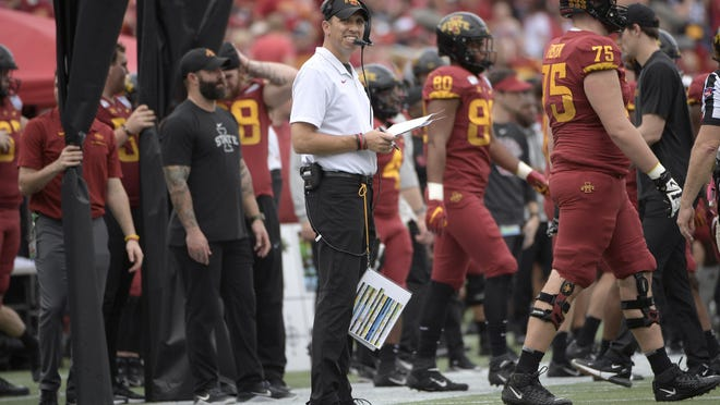 Iowa State head coach Matt Campbell, center, watches from the sideline during the first half of the Camping World Bowl NCAA college football game against Notre Dame Dec. 28 in Orlando, Florida.