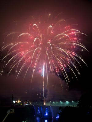 Fireworks ignite over the Henley Bridge on July 4, 2017.