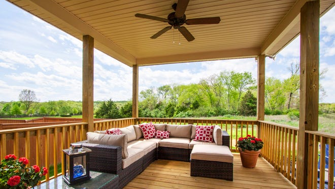 A large covered outdoor living area is one of the features of this Jones Co. home in Nolensville's Whitney Park neighborhood.