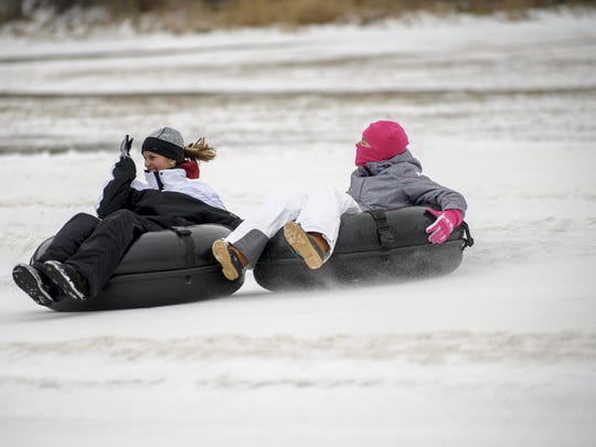 Lynsey Uitenbroek, left and her daughter Chloe go for a very quick tube ride at Sleepy Hollow.