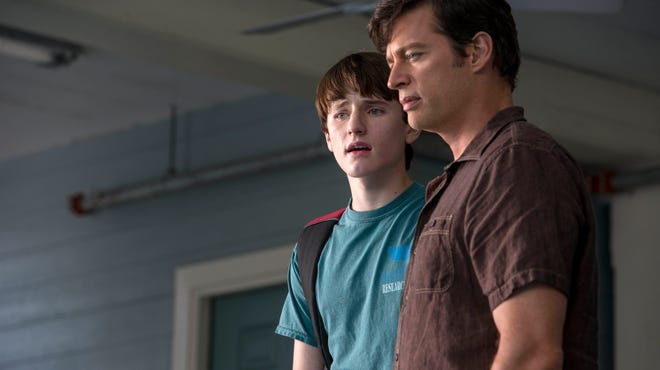 """Harry Connick Jr., right, as Dr. Clay Haskett, and Nathan Gamble as Sawyer Nelson, are shown in a scene from the film, """"Dolphin Tale 2."""""""