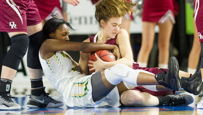 Memphis' Ariel Lane (21) and Oak Ridge's Courtney Ellison (10) fight for the ball during Game 1 of the 2017 TSSAA Class AAA State Girls' Basketball Tournament game between Memphis Central and Oak Ridge at the Murphy Center in Murfreesboro, Tennessee on Wednesday, March 8, 2017.