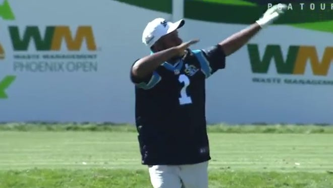 Harold Varner put on a Cam Newton jersey during the Phoenix Open.