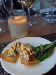Halibut and citrus ceviche marinating mandarin, mint, cilantro and basil in Sriracha aioli and delicately piled on wonton crisps at Essense at Two Bunch Palms in Desert Hot Springs.