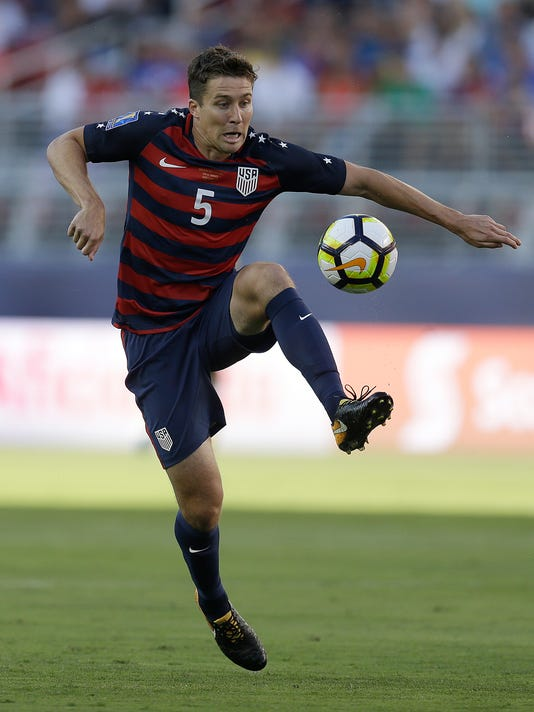 """FILE - In this  July 26, 2017, file photo, United States' Matt Besler controls the ball during the first half of the Gold Cup final soccer match against Jamaica, in Santa Clara, Calif. Besler got a concussion and became an author. The U.S. national team regular began journaling last year as part of his recovery. The result was his book, """"No Other Home: Living, Leading, and Learning What Matters Most."""" The book's release on Nov. 7 comes at a particularly busy time for Besler, who is in the midst of World Cup qualifying with the national team, and the playoff push for Sporting Kansas City. (AP Photo/Ben Margot, File)"""