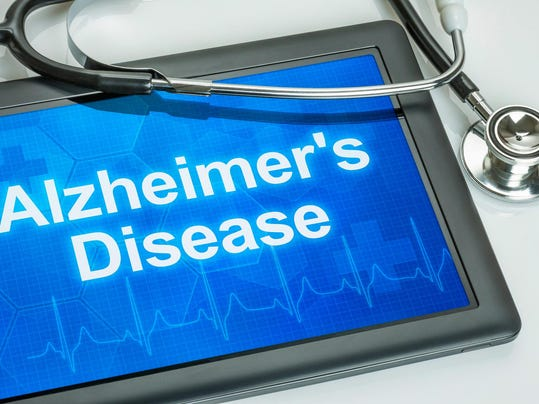 Tablet with the diagnosis alzheimer's disease on the display