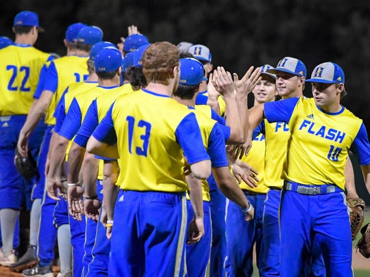 The Henderson Flash players gather on the field after defeating the Dubois County Bombers 5-4 to force a game three in the Ohio Valley League playoffs at B.T. Wayne Field in Henderson Saturday, July 21, 2018.