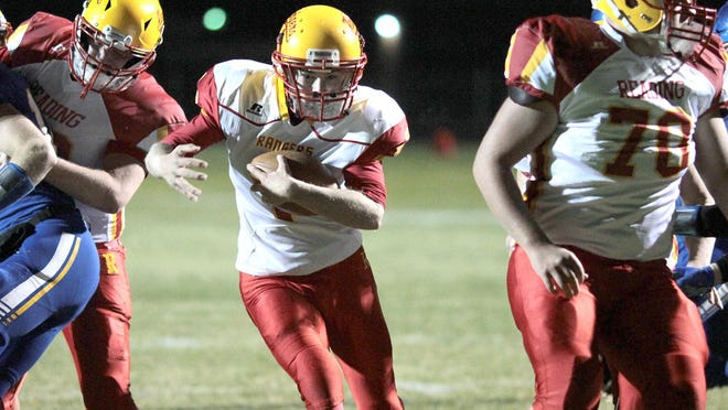 Reading's Zachary Goodwin scores a touchdown during Friday's district final at Centreville. Brandon Watson/Sturgis Journal