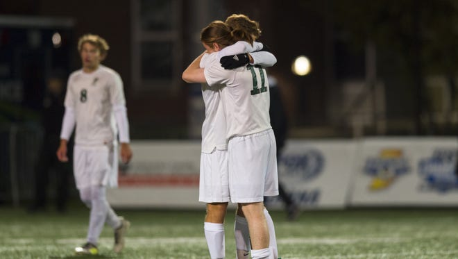 Covenant Christian High School players react after their loss in the IHSAA Boys' Soccer Class A state final game, Friday, October 27, 2017, at the Bud and Jackie Sellick Bowl on the campus of Butler University in Indianapolis. Fort Wayne won 2-1.