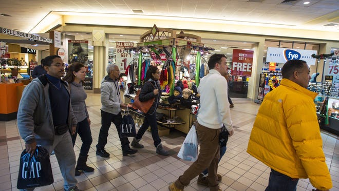 Shoppers walk through the University Mall in South Burlington on Wednesday.