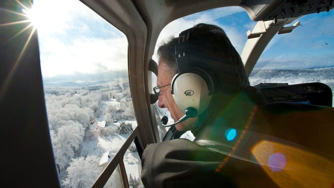 Gov. Peter Shumlin flies over Hinesburg in a helicopter as he surveys damage from this week's snow storm on Saturday.