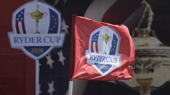 A Ryder Cup flag blowing in the wind the tournament at Hazeltine National Golf Club in Chaska, Minn., in September of 2016. The Ryder Cup was postponed until 2021 in Wisconsin because of the COVID-19 pandemic that raised too much uncertainty whether the loudest event in golf could be played before spectators. [Charlie Riedel/Associated Press File)