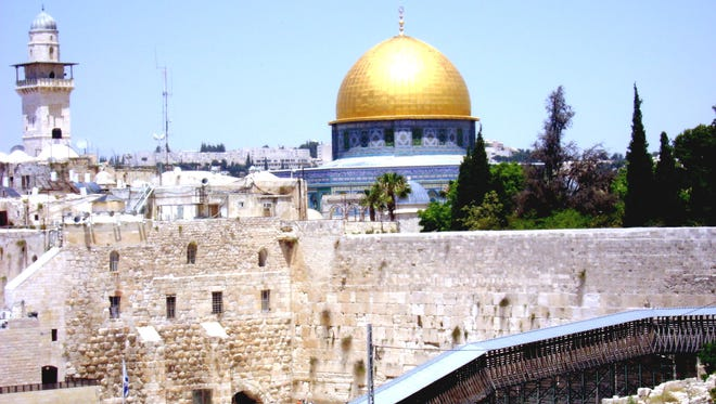 The Western Wailing Wall in Jerusalem, with Dome of the Rock in the background.