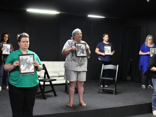 """Eight photographs of loved ones are lost are displayed for the audience in this rehearsal scene from """"The Door,"""" one of four one-act plays to be presented in the Black Box Theatre at Abilene Community Theatre. From left: Kim Talafuse, Maya Jordan, Christine Schutter, Karen Reese, Kendra Brown, Crystal Hale, Susan Steele and Amanda Keith."""