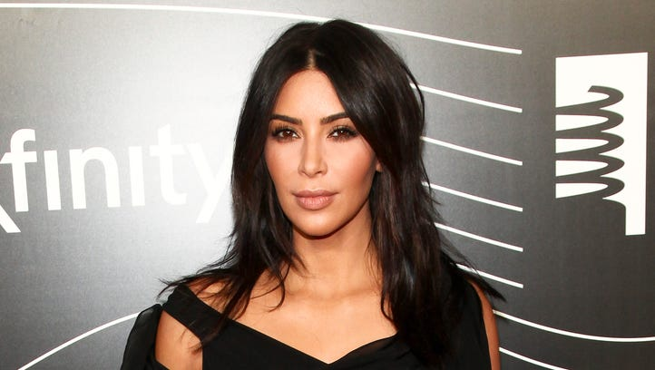 Kim Kardashian has dropped her lawsuit against an online media outlet after receiving an apology.