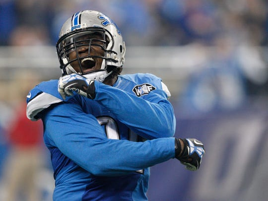 Detroit Lions defensive end Ezekiel Ansah (94) celebrates after forcing a turnover against the Philadelphia Eagles during the third quarter of a NFL game on Thanksgiving at Ford Field.
