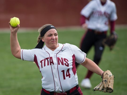 Gibson Southern's outfielder Colby Rogers (14) throws in the ball agains Castle during a softball tournament at Gibson Southern High School on Saturday, March 31, 2018.