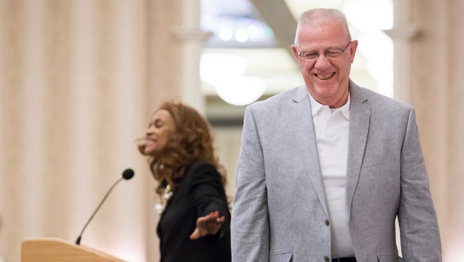 Rep. Harvey Kenton smiles as he walks from the runway at a scholarship fundraising fashion show at the Chase Center.
