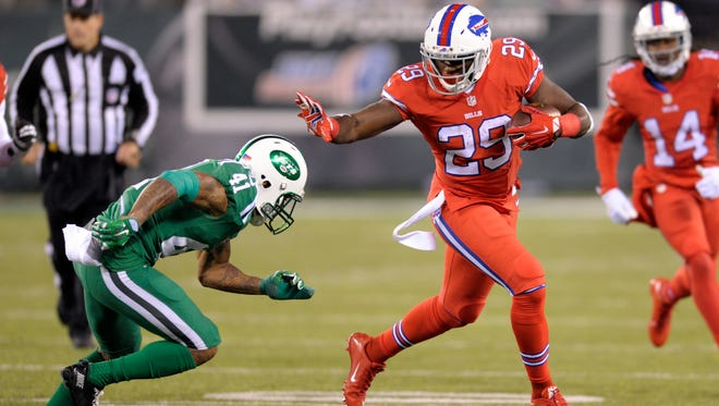 Buffalo Bills running back Karlos Williams (29) stiff arms New York Jets defensive back Buster Skrine (41) during the second half of an NFL football game, Thursday, Nov. 12, 2015, in East Rutherford, N.J. (AP Photo/Bill Kostroun)