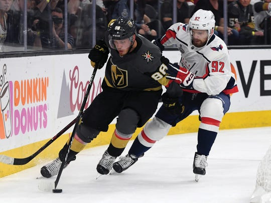 LAS VEGAS, NV - JUNE 07:  Nate Schmidt #88 of the Vegas Golden Knights is defended by Evgeny Kuznetsov #92 of the Washington Capitals during the second period in Game Five of the 2018 NHL Stanley Cup Final at T-Mobile Arena on June 7, 2018 in Las Vegas, Nevada. The Capitals defeated the Golden Knights 4-3.