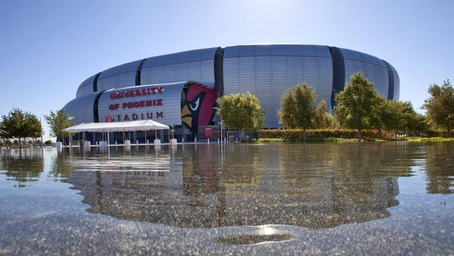 FILE - University of Phoenix Stadium is reflected in the pool at Sportsman's Park in Glendale, Ariz. NFL owners have awarded the 2015 Super Bowl to the Phoenix area.