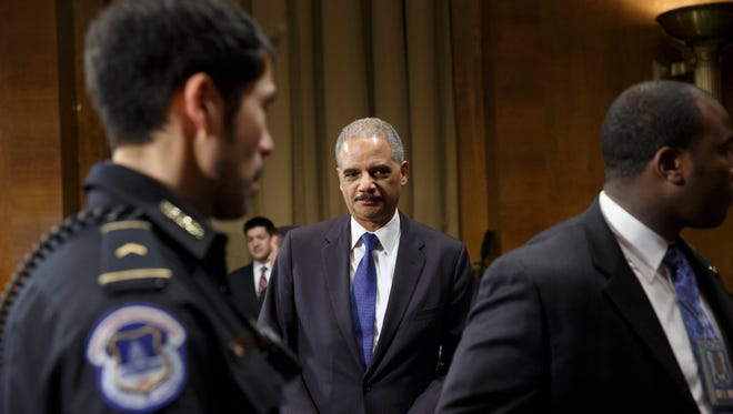Attorney General Eric Holder arrives on Capitol Hill to testify before the Senate Judiciary Committee oversight hearing on the Justice Department.