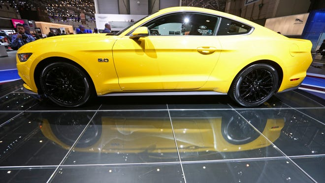 A Ford Mustang automobile, produced by Ford Motor Co., stands on display on the company's stand on the opening day of the 84th Geneva International Motor Show in Geneva, Switzerland, on Tuesday, March 4, 2014.
