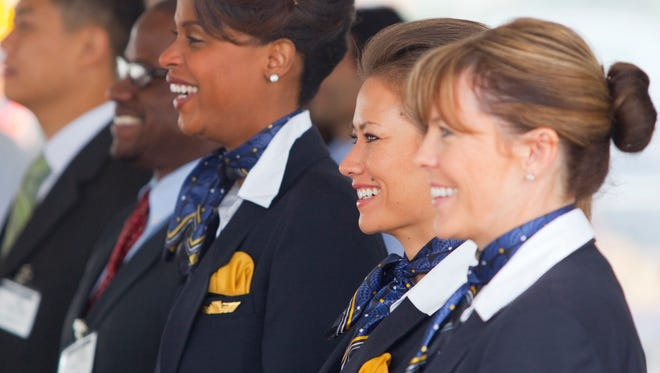 United Airlines flight attendants, from right, Laureen Kelley, Patricia Chisum, and Vonn Crosby listen to a presenter as United's first Boeing 787 Dreamliner is presented at Boeing's factory in Wash., on , Aug. 3, 2012.