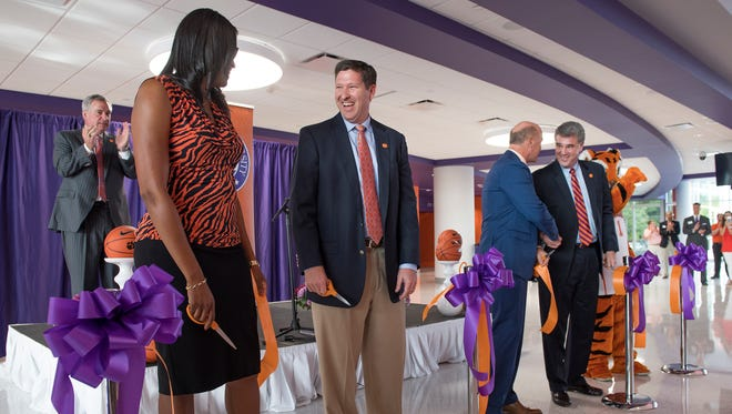 From left, Clemson's women's basketball coach Audra Smith, men's basketball coach Brad Brownell, Clemson president Jim Clements and Clemson athletic director Dan Radakovich cut the ribbon to officially open Clemson's newly renovated Littlejohn Coliseum on Friday, Oct. 14, 2016.
