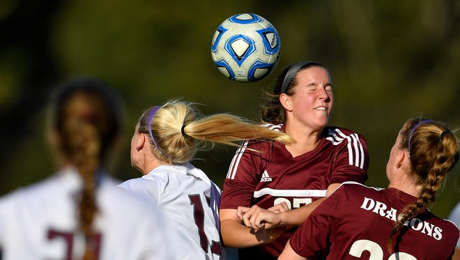 Franklin's Caroline Defranco (13) goes for a header with Collierville's Holly Stalls (27) during the first half of the Class AAA semi-final at the Richard Siegel Soccer Complex, Thursday, Oct. 26, 2017, in Murfreesboro, Tenn.