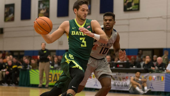 Baylor guard Jake Lindsey (3) drives past Randall guard Kashus Lyons (10) in the first half of an NCAA college basketball game in Fort Hood on Saturday, Dec. 9, 2017.