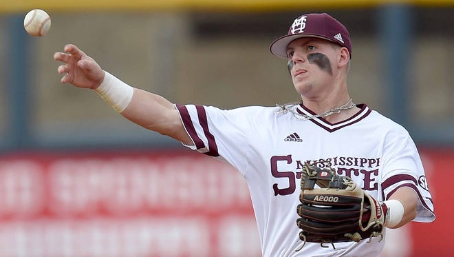 Mississippi State's Hunter Stovall throws to first base on Tuesday, April 24, 2018, before the Governors Cup baseball game at Trustmark Park in Pearl, Miss.
