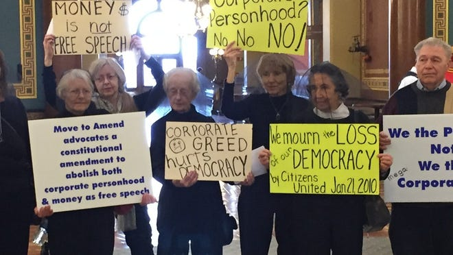 These activists protested in the Iowa Capitol Rotunda on Wednesday to mark the fifth anniversary of a U.S. Supreme Court ruling that allowed corporations to spend unlimited money on elections.