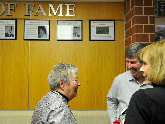 Hall of fame committee member Connie Hoke, left, jokes