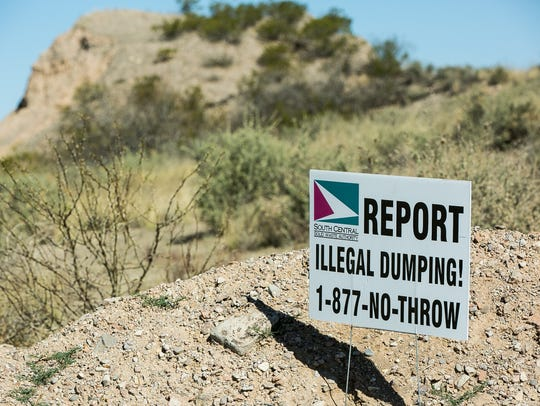 A sign is posted along Doña Ana Road near Thomas Chavez's