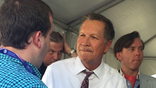 Gov. John Kasich greets supporters after an event with