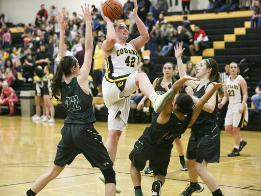 Cascade's Halle Wright (42) goes up for a basket in