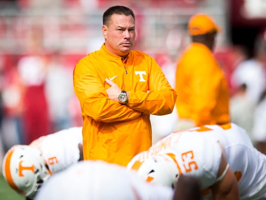Tennessee head coach Butch Jones watches his players
