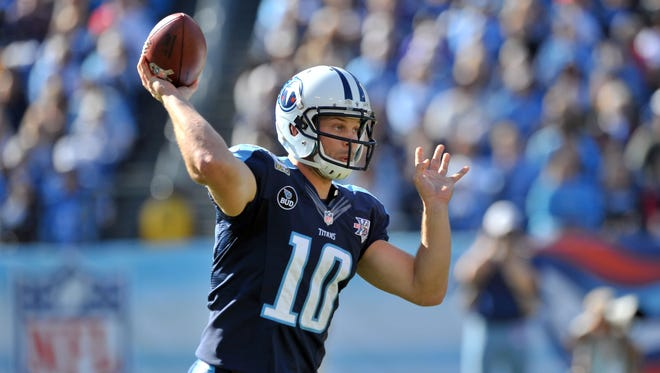 Tennessee Titans quarterback Jake Locker (10) passes against the Jacksonville Jaguars during the first half at LP Field.