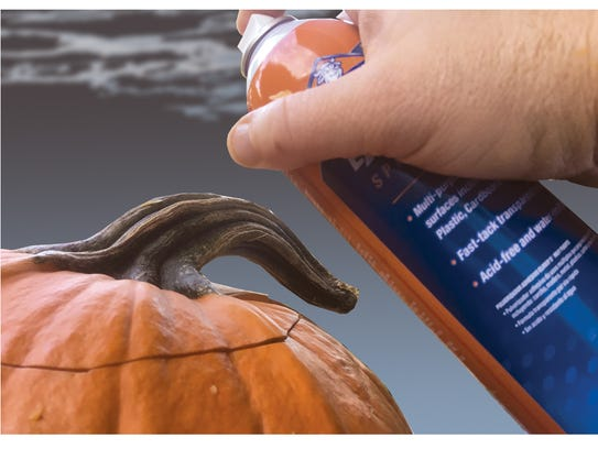 To make the hair, spray the lid of the pumpkin with spray glue.