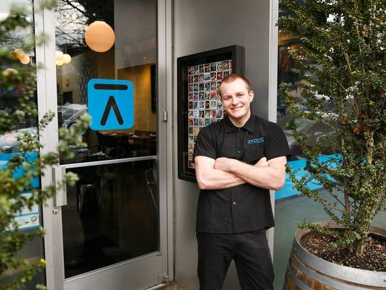 Ryan Toepfer stands outside of Portland restaurant
