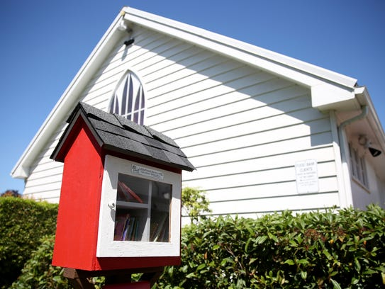 A grand opening for a Little Free Library at Trinity