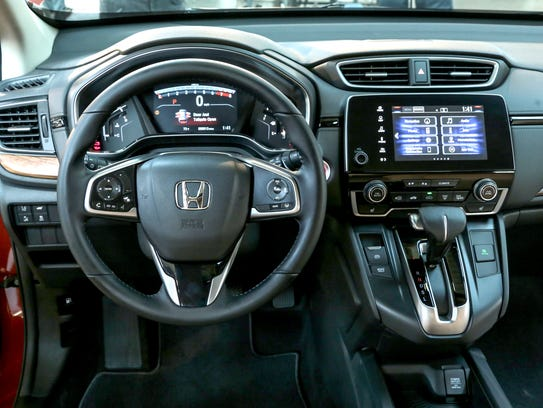 The interior of the new 2017 Honda CR-V crossover is seen on display ...