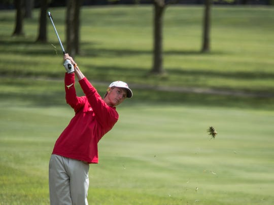 Alex Yost of Arrowhead observes the direction of his ball after he makes a hit during the Homestead Sectional golf tournament May 30.