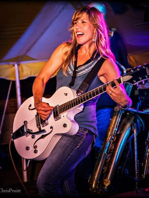 Michelle Jerabek, the lead singer of Copper Box, also plays guitar, saxophone and other instruments.